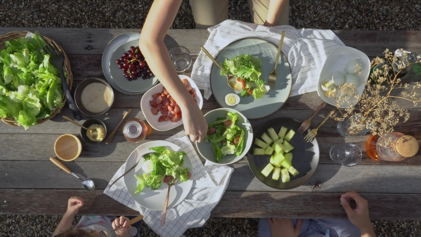 Family dinner with organic salad on rustic wooden table, Food healthy organic vegetable concept with top view