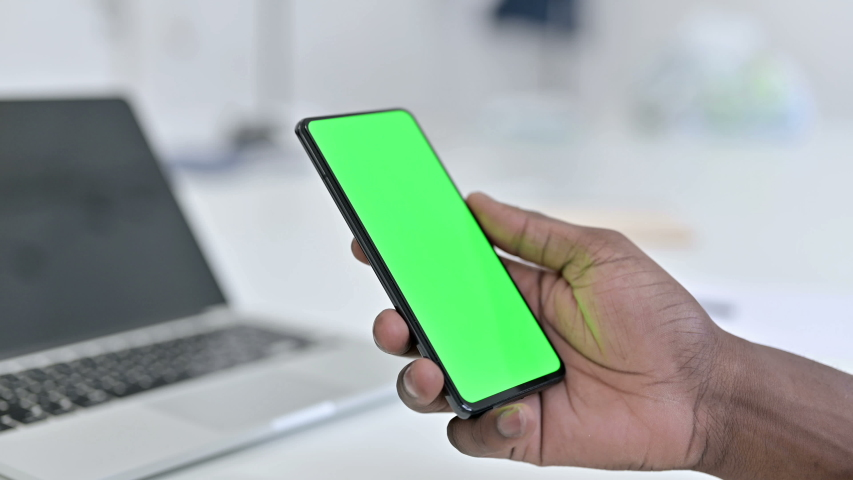 African Man Hand Using Green Smartphone Screen, Chroma key   Shutterstock HD Video #1045813129