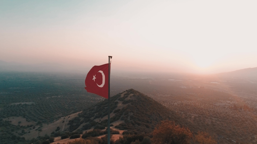 Turkish flag at the top of the mountain. turkish flag at the top at sunset