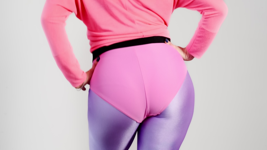 Funny reto fitness. Female butt in leggings doing fitness exercises. Athlete workout from the 80's. Vintage aerobic 80s 90s style. Stupid-looking. Dancing ass.