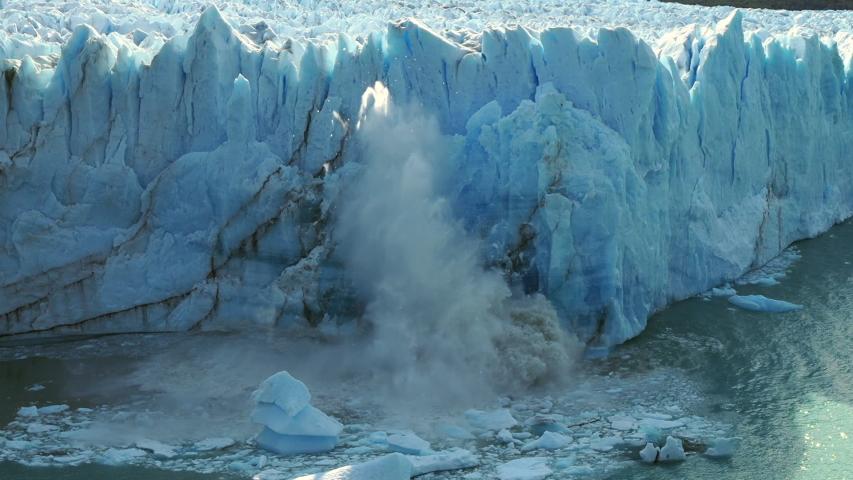 Perito Moreno glacier in Los Glaciares National Park near El Calafate, Argentina,  view of massive ice chunks collapsing into the water.