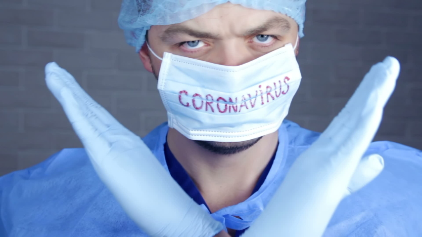 Medical lab worker with protective gloves showing stop sign on hospital . Novel coronavirus (2019-nCoV). MERS chinese infection, atypical pneumonia. Wuhan, China | Shutterstock HD Video #1045852396