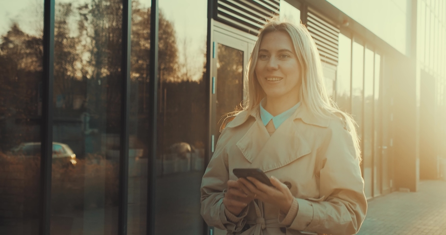 Meeting attractive business woman. Young business people confident pretty. Female goes with smartphone in the city. Growing, success. 4K slow motion video | Shutterstock HD Video #1045883359