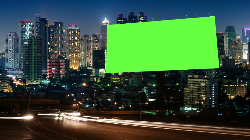 Time Lapse of Blank Billboard with a Green Screen on Night Street with light trails, city night background. | Shutterstock HD Video #1045895941