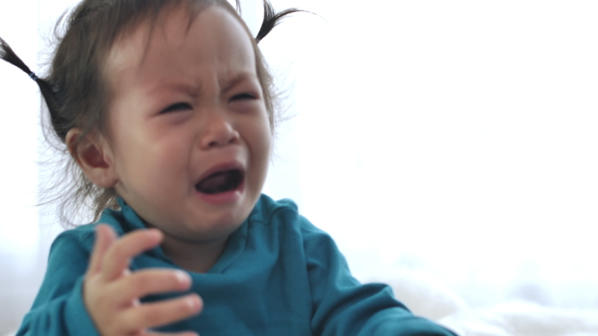 Asian girl Crying and fussing. When a small child is sleepy, crying is a sign that it must be taken to bed. | Shutterstock HD Video #1045937092