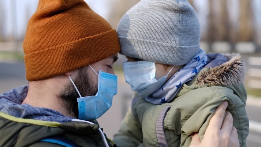 Father with son in a medical mask. Virus epidemic