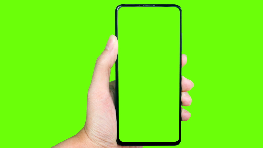 Man's hand holding a mobile telephone with a vertical green screen in tram chroma key smartphone technology cell phone touch message display hand with luma white and black key   Shutterstock HD Video #1045989916