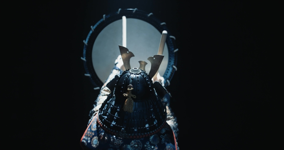 Japanese man in historical samurai costume playing on taiko drum with kata moves, isolated on black background - culture, history concept 4k footage Royalty-Free Stock Footage #1045994269