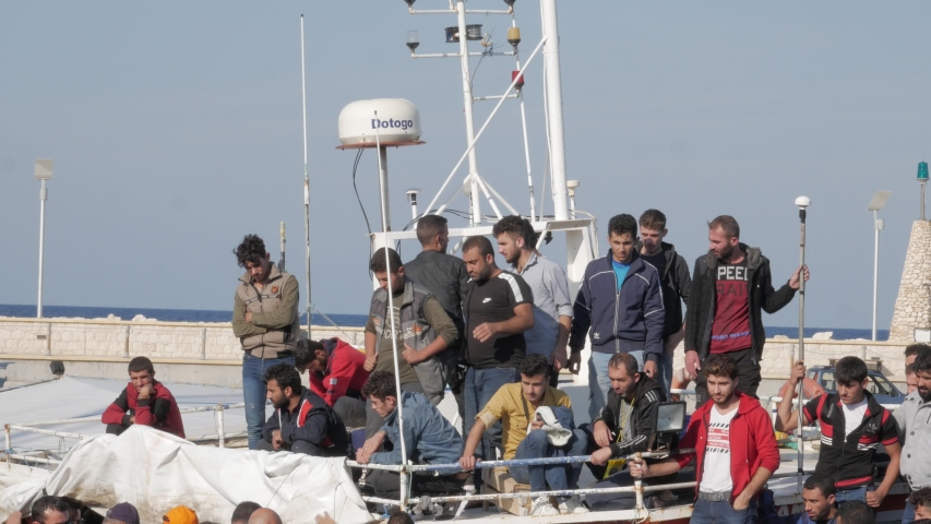 Latchi Polis Chrysochou / Cyprus - 11 04 2019: A boat full of illegal immigrants from the Syrian war arrives at the port of Latchi Polis Chrysochou, Cyprus on November 4th, 2019.