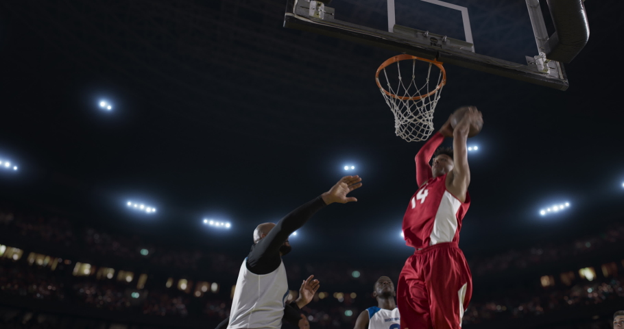 Basketball players on big professional arena during the game. Tense moment of the game. View from below the basket | Shutterstock HD Video #1046031361