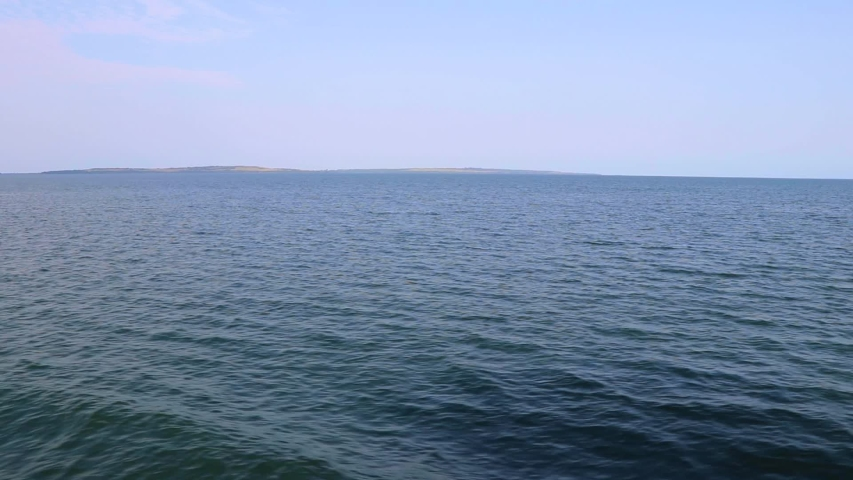 Distant island and open water at Lake Victoria seen froming ferry | Shutterstock HD Video #1046044783