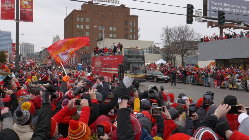 """Kansas City, MO / United States of America - February 5th 2020: Chiefs Kingdom Championship Parade, a double decker bus carrying Patrick Mahomes, 2019 Super Bowl MVP, as tens of thousands cheer """"MVP"""""""
