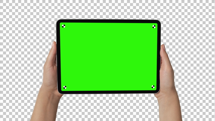New York / USA, July 28 2019: - Holding iPad Pro Tablet In Female Hands with alpha channel background and trackers for easy screen replacement.