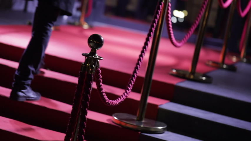 Feet of guests climbing the red carpet, anonymous vip persons