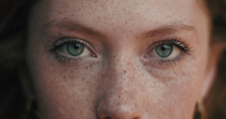 Close up of Woman's Face, Girl opening her Beautiful blue azzure Eyes, Attractive Ginger. Natural Beauty with Freckles. Gorgeous woman with long Eyelashes and Attractive Appearance. Slow motion.