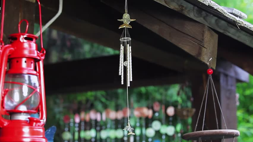 Red classical oil lamp & air bells with dolphin. | Shutterstock HD Video #10460558