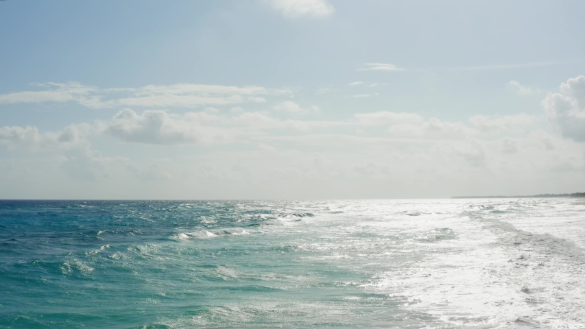 Sea expanse landscape. Beautiful blue sea and large calm waves float on the Atlantic Ocean. Ocean and sky background landscape. | Shutterstock HD Video #1046056672