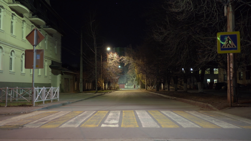 Simferopol empty city streets with street lights at night in autumn. | Shutterstock HD Video #1046083711