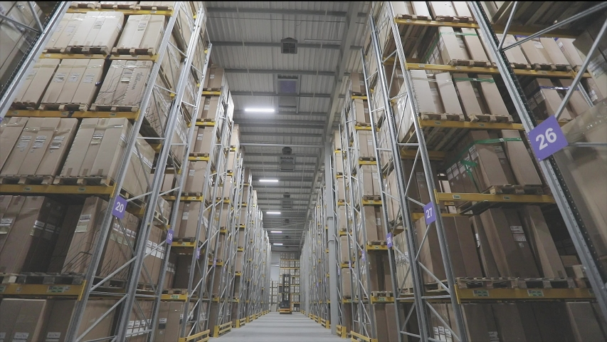 Turning off the lights in the warehouse. End of the day, turning off lighting in a large warehouse | Shutterstock HD Video #1046092408