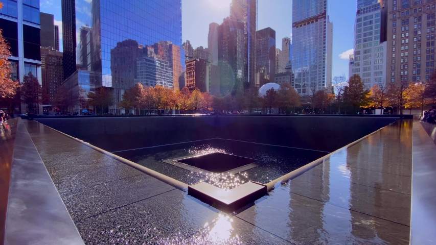New York, NY, USA - 11-10-2019 the 9/11 memorial with a lot of reflection on a sunny day of autumn.