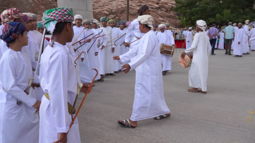 OMAN MUSCAT/ NOVEMBER 11, 2019:  Omani folk band performing Omani traditional dance. young boys dancing with drums
