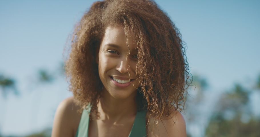 Portrait of beautiful healthy african american woman smiling and living confidently, female healthy living and outdoors fitness concept | Shutterstock HD Video #1046105938