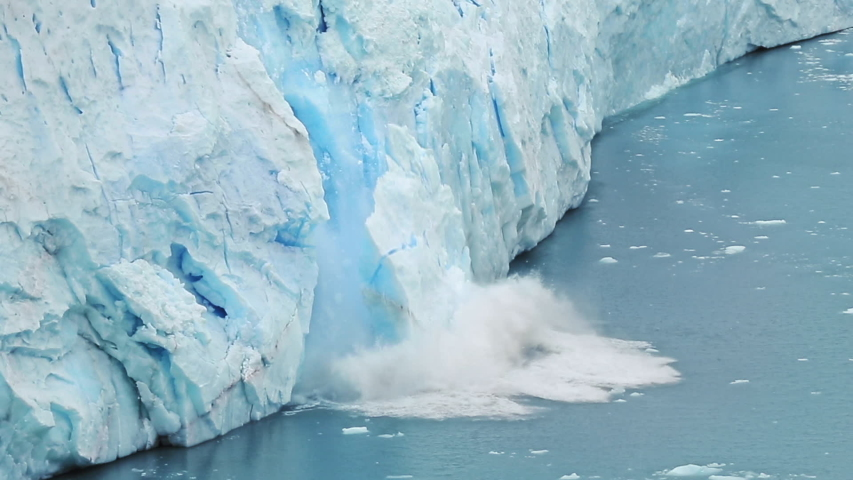 Global Climate changes awareness video - the glaciers are warming and melting faster.  The glacier gives the lake Argentino huge blocks of ice. Ice detaches and falls into the Icebergs Channel. Royalty-Free Stock Footage #1046113537