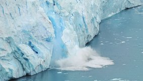 Global Climate changes awareness video - the glaciers are warming and melting faster.  The glacier gives the lake Argentino huge blocks of ice. Ice detaches and falls into the Icebergs Channel.