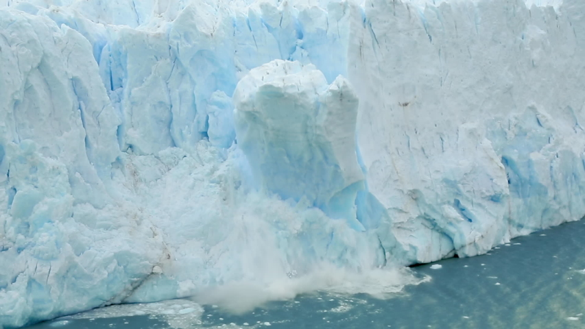 Global Climate change footage: nature is declining, and glaciers are melting. Climate awareness and warming video. The Perito Moreno glacier in Los Glaciares National Park collapses into a large lake. | Shutterstock HD Video #1046113540