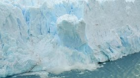 Global Climate change footage: nature is declining, and glaciers are melting. Climate awareness and warming video. The Perito Moreno glacier in Los Glaciares National Park collapses into a large lake.