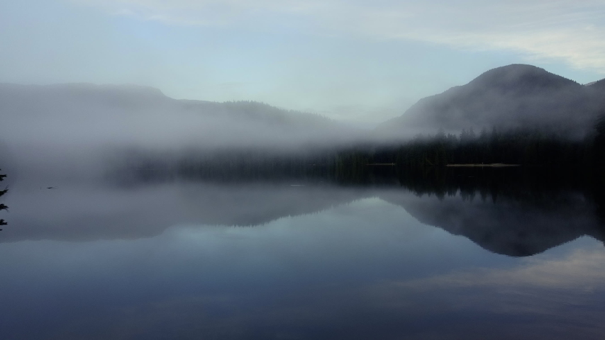 Fog over the crystal clear lake in the morning | Shutterstock HD Video #1046113759