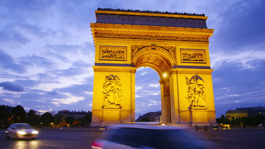 Paris, France, Arch of triumph and Champs Elysees at night, time-lapse in motion, hyperlapse.