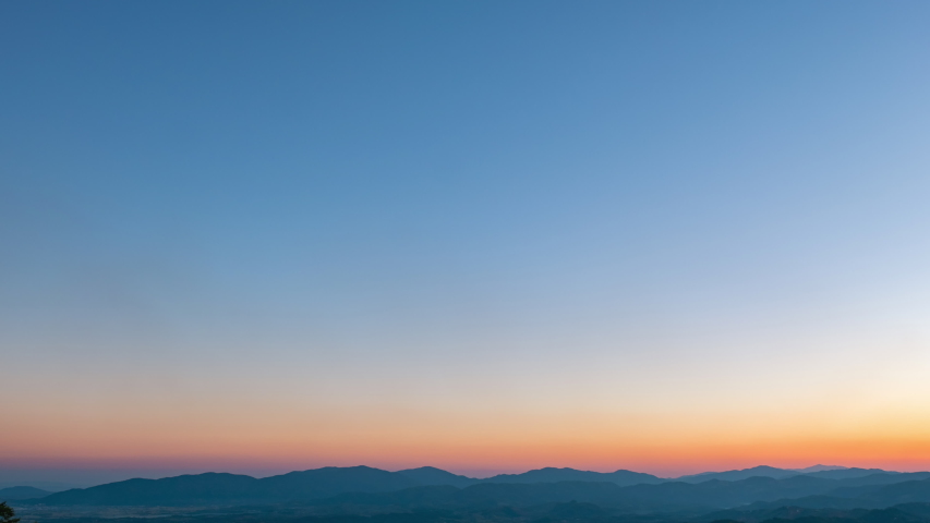 Day to Night Timelapse, Beautiful orange and violet sunset dusk scene above the high mountain turning to the night scene with many stars. 4K Video.   Shutterstock HD Video #1046138245