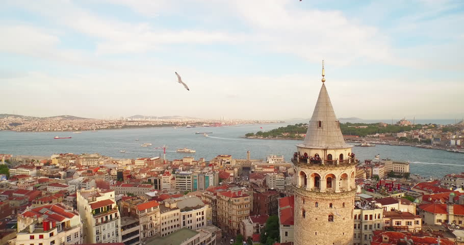 4k footage of Bosporus in the sun set having Galata tower in the middle.  Camera rotates around the Galata tower. | Shutterstock HD Video #10461470