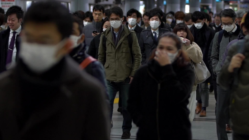 Tokyo, Japan-04 February, 2020: Slow motion of Japanese business men and women wear face masks. People wearing mask at metro as precautionary measures during coronavirus from Wuhan, China