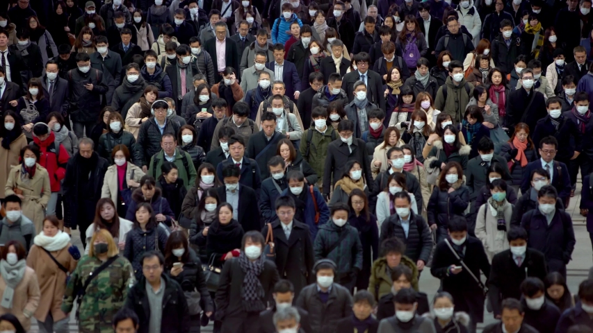 Tokyo, Japan-04 February, 2020: 4K, Concept of coronavirus quarantine, COVID-19. Large crowd of business people with medical face mask. Air pollution. The virus has caused emergency situation.