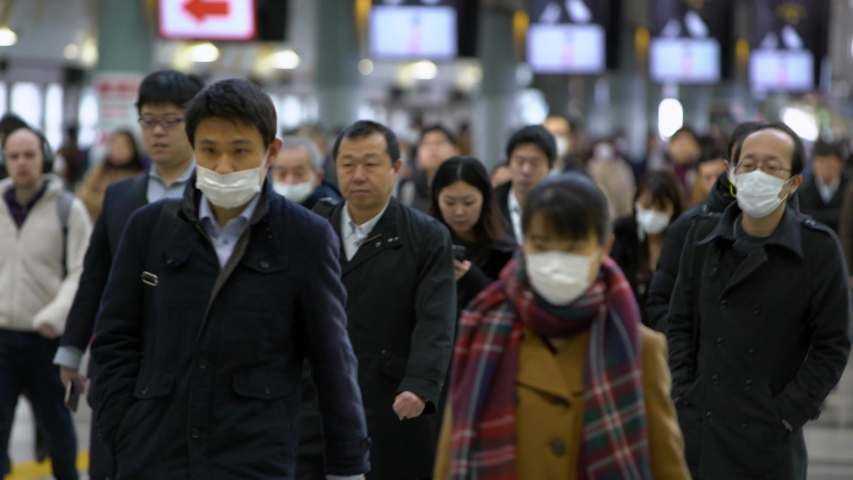 Tokyo, Japan-04 February, 2020: 4K, Japanese business men and women wear face masks. People wearing the mask at the Shinagawa Station as precautionary measures during coronavirus from Wuhan, China