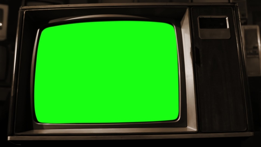 "Retro Wood Style TV Set with Green Screen. Sepia Tone. Dolly In. You can Replace Green Screen with the Footage or Picture you Want with ""Keying"" effect in After FX (check out tutorials on YouTube). 