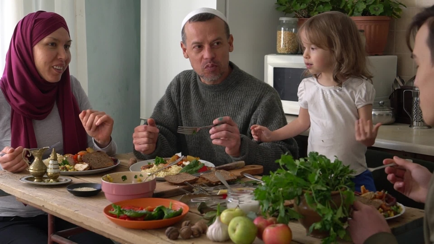 Happy authentic arabic muslim family have a dinner in kitchen together. Concept of religion, lifestyle, social, family. Slow Motion | Shutterstock HD Video #1046177506