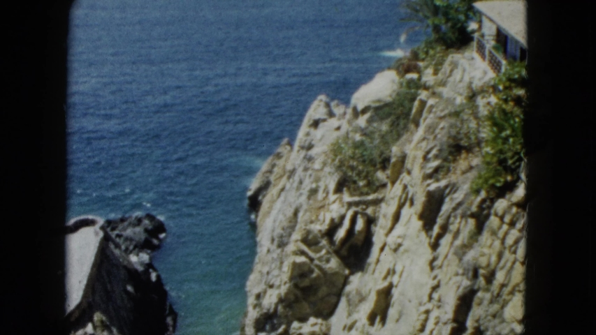 ACAPULCO MEXICO-1962: Millions Of Years Of Ocean Corrosion Has Caused This Rock To Split In Half