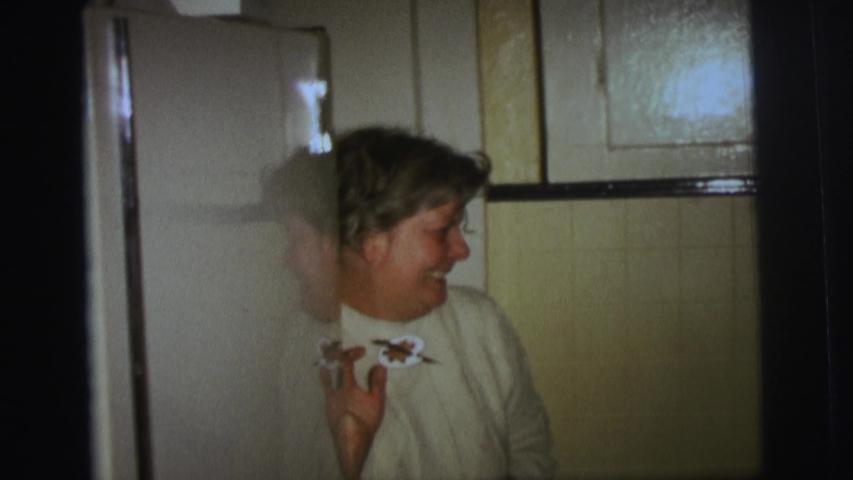 LYNBROOK NEW YORK-1973: Grandma Talks To The Camera As Little Boy Mugs The Camera During Birthday Party