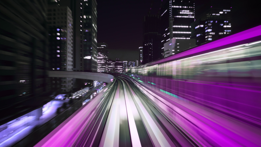 Hyper time-lapse of a Train moving through a futuristic neon city. Cyberpunk theme. Seamless Looping. | Shutterstock HD Video #1046231359