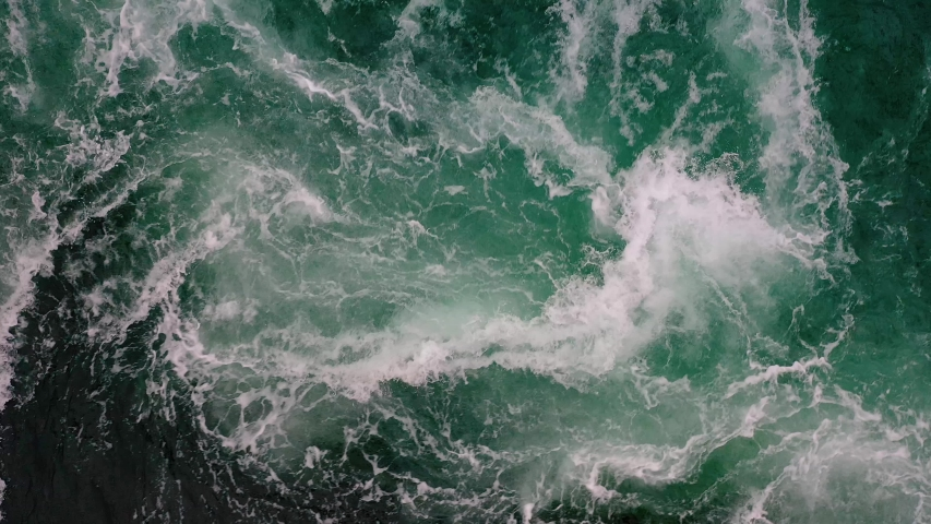 Waves of water of the river and the sea meet each other during high tide and low tide. Whirlpools of the maelstrom of Saltstraumen, Nordland, Norway | Shutterstock HD Video #1046232130