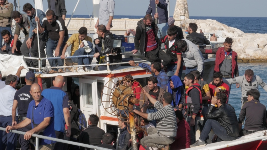 Latchi Polis Chrysochou / Cyprus - 11 04 2019: A boat full of illegal immigrants from the Syrian war arrive at the port of Latchi Polis Chrysochou, Cyprus on November 4th, 2019.
