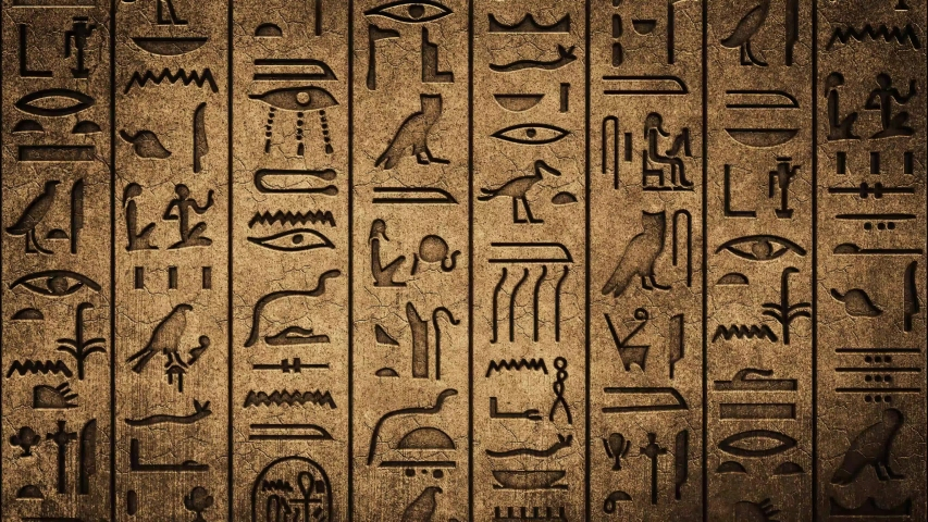 Hieroglyphics on Ancient Egyptian Stone Carving background Royalty-Free Stock Footage #1046255161