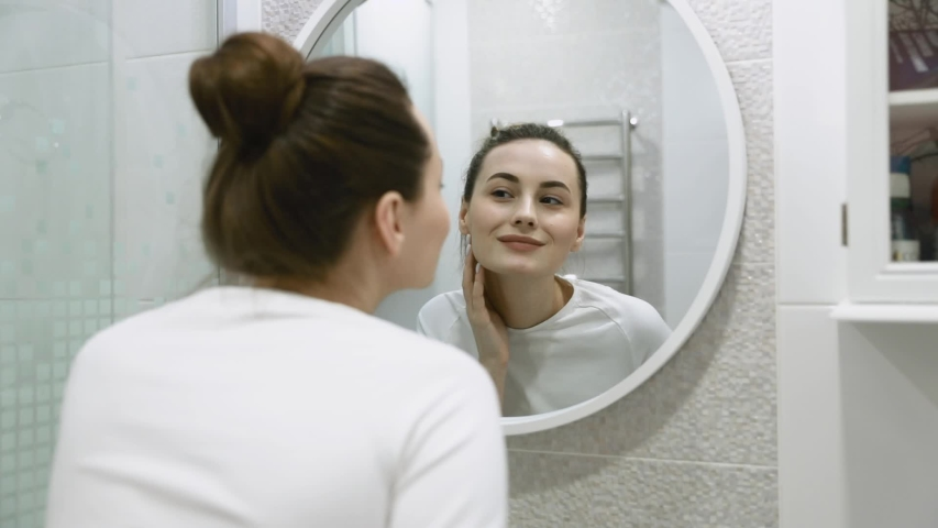 Cosmetology. Portrait Of Beautiful Mature Woman Massaging Fresh Healthy Facial Skin. Closeup Of Healthy Middle Aged Female Model Touching Beauty Face. Skin Care. High Resolution | Shutterstock HD Video #1046258395