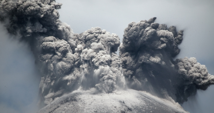 Spectacular volcanic eruption. Huge boulders are thrown from the ash cloud. Reventador volcano erupting in February 2020, situated in a remote part of the Ecuadorian Amazon surrounded by rainforest. | Shutterstock HD Video #1046260879