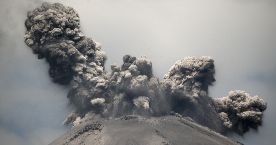 Spectacular volcanic eruption. Huge boulders are thrown from the ash cloud. Reventador volcano erupting in February 2020, situated in a remote part of the Ecuadorian Amazon surrounded by rainforest.