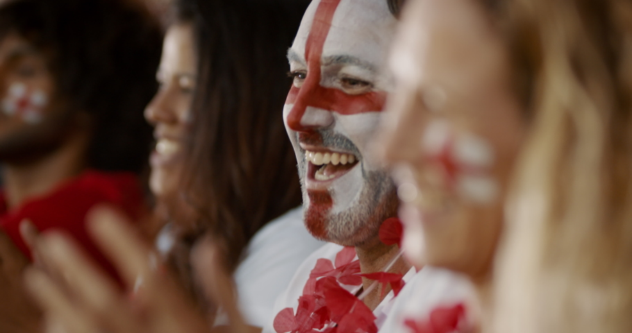 Happy English soccer supporters celebrating a win. Group of fans cheering for England team from fan zone after wining a championship. | Shutterstock HD Video #1046269006