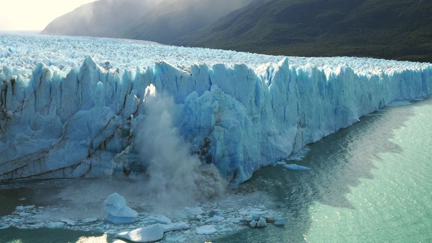 Perito Moreno Glacier in Los Glaciares National Park near El Calafate, Patagonia, Argentina, view of ice chunks collapsing into the water.  Royalty-Free Stock Footage #1046269366